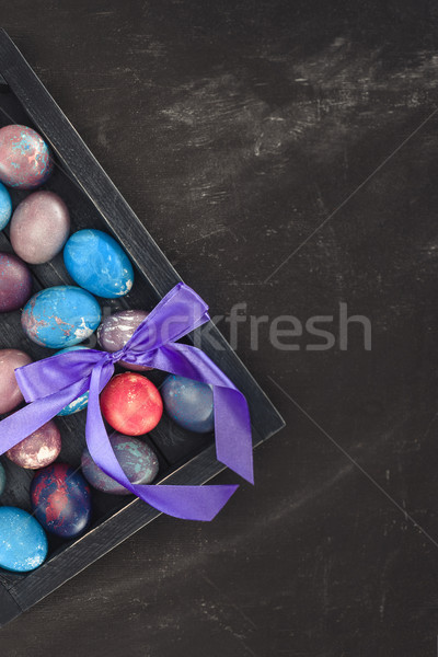top view of traditional easter eggs in gift box with bow Stock photo © LightFieldStudios