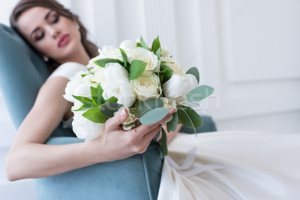 selective focus of bride with wedding bouquet sitting in armchair Stock photo © LightFieldStudios