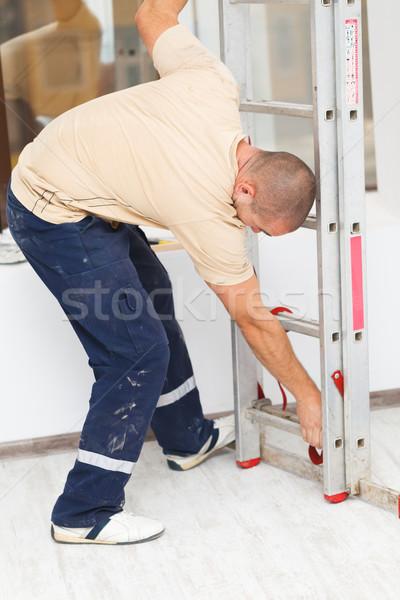 Handyman Mounting Step Ladder Stock photo © Lighthunter
