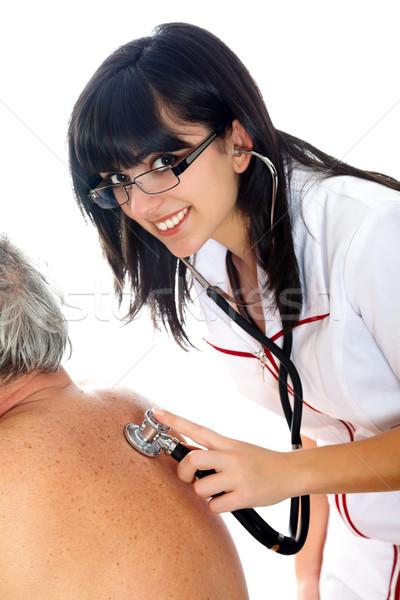 Idős orvosi vizsgálat mosolyog fiatal nő sztetoszkóp idős Stock fotó © Lighthunter