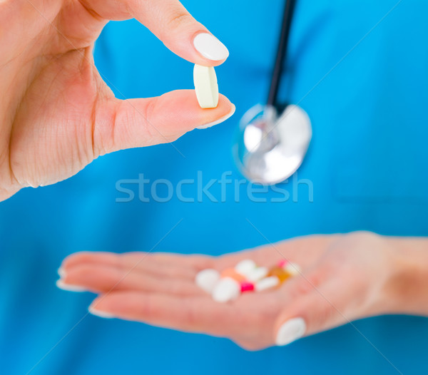 Drugs held by doctor Stock photo © Lighthunter