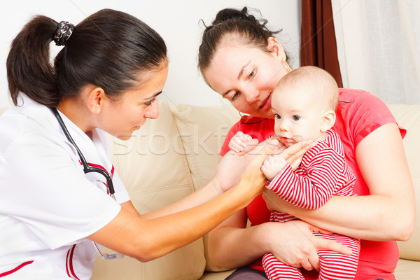 Pediatrician checking a baby Stock photo © Lighthunter