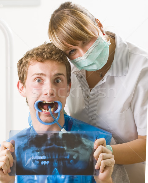 A dentist and her patient posing with funny facial expression. Stock photo © Lighthunter