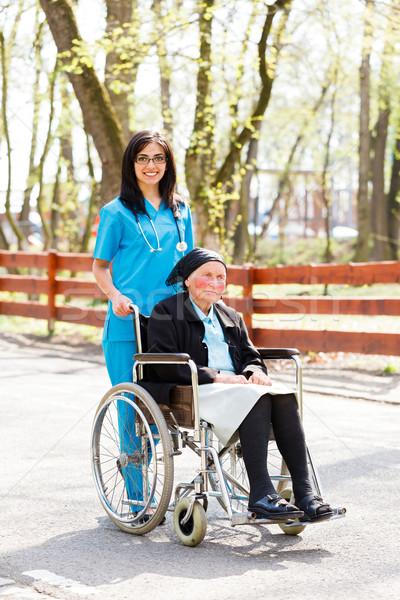 Stockfoto: Arts · patiënt · mooie · verpleegkundige · Blauw · jas