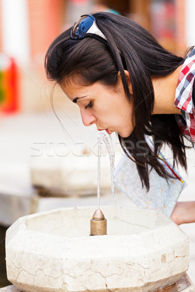 Tourist Drinking Fresh Water Stock photo © Lighthunter