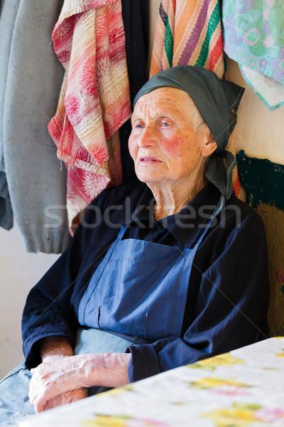 Cansado ancianos rural mujer sesión Foto stock © Lighthunter