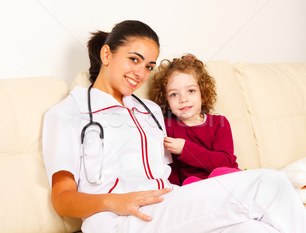 Smiling padiatrician with a little girl Stock photo © Lighthunter