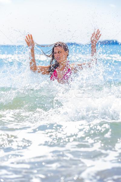 Meglepetés fiatal barna hajú nő nagy hullám Stock fotó © Lighthunter
