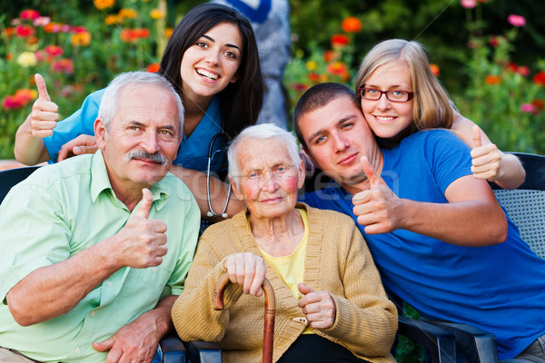 Stock photo: Carer and Family Thumbs up