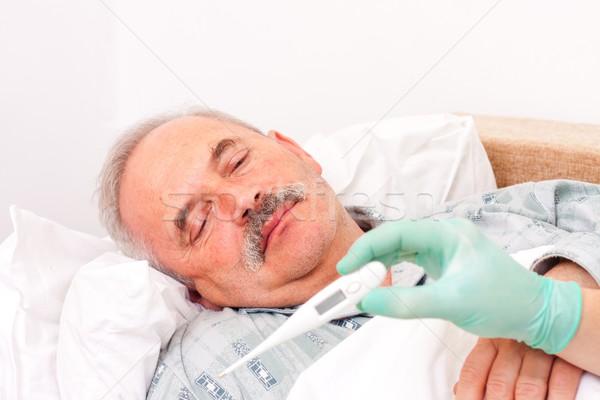 Senior man with fever Stock photo © Lighthunter