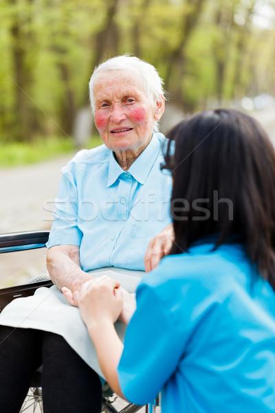 Idős hölgy tolószék ül kéz nő Stock fotó © Lighthunter