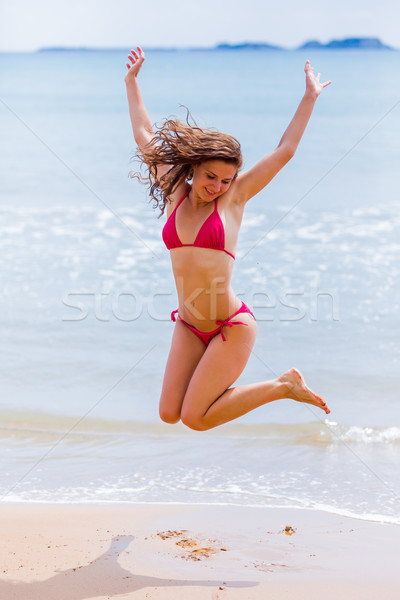 Excitation surcharge heureux jeunes brunette femme Photo stock © Lighthunter