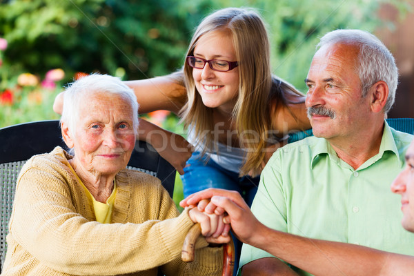 Family Visiting Sick Grandmother in Nursing Home Stock photo © Lighthunter
