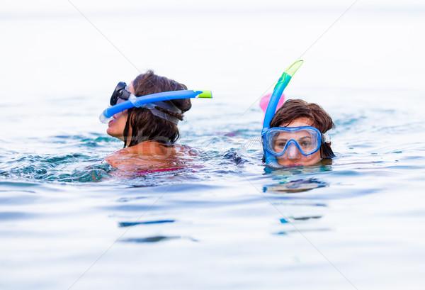 Dziewcząt działania znajomych morza snorkeling Zdjęcia stock © Lighthunter