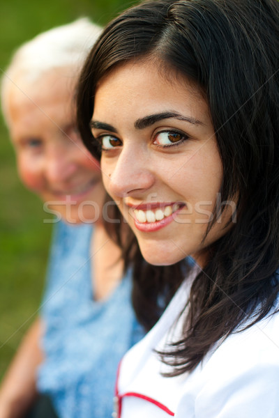 Doctor / Nurse outdoors with an elderly woman Stock photo © Lighthunter