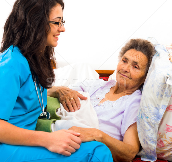 Kind Nurse with Elderly Stock photo © Lighthunter