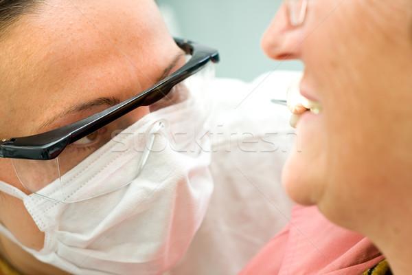 Onderzoek tandarts jonge onderzoeken oude oraal Stockfoto © Lighthunter