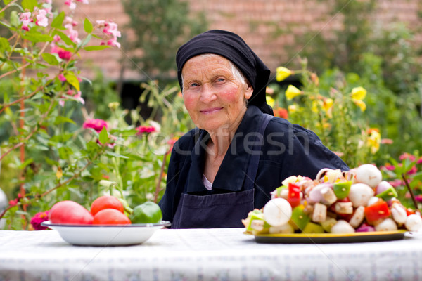 Elderly woman at the table Stock photo © Lighthunter
