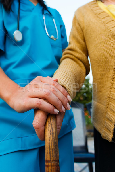 Caring Doctor and Senior Lady Hands Stock photo © Lighthunter
