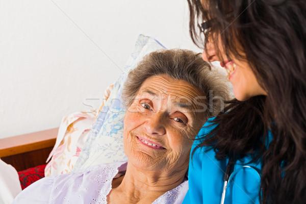 Kind Nurse with Elderly Stock photo © Lighthunter