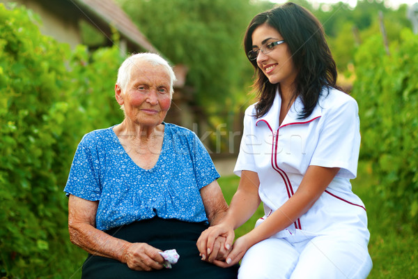 Caring doctor with sick elderly woman outdoors Stock photo © Lighthunter