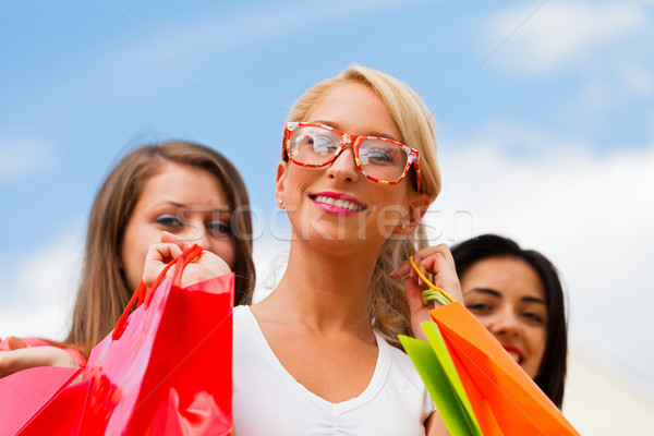 Girl With Her Friends After Shopping Stock photo © Lighthunter