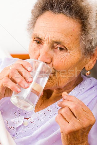 Senior Woman Taking Supplements Stock photo © Lighthunter