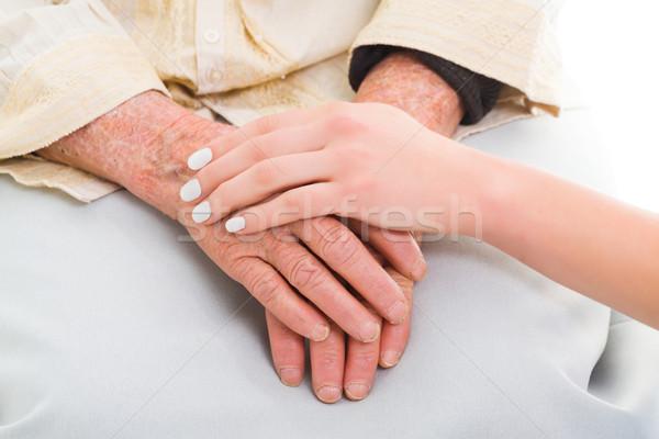 Yardım muhtaç yaşlı eller genç kişi Stok fotoğraf © Lighthunter