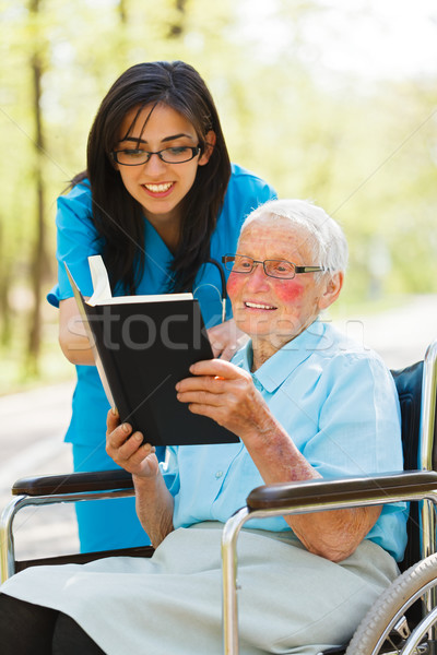 Elderly Lady in Wheelchair Reading Stock photo © Lighthunter