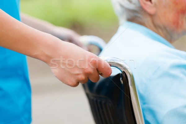Tolószék idős nő nővérek kezek kéz nők Stock fotó © Lighthunter