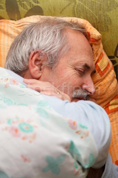 Starszy człowiek relaks bed Zdjęcia stock © Lighthunter