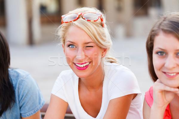 Cute mrugnięcie blond kobieta przepiękny uśmiech Zdjęcia stock © Lighthunter