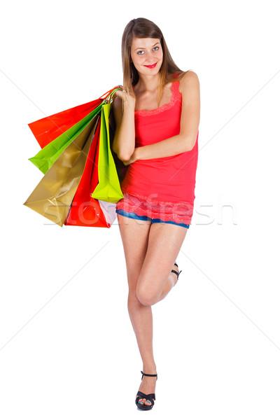 O que compras hoje olhando jovem senhora Foto stock © Lighthunter
