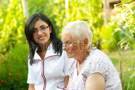 Caring doctor with elderly woman Stock photo © Lighthunter