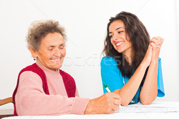 Nurse Helping Elderly Register for Nursing Home Stock photo © Lighthunter