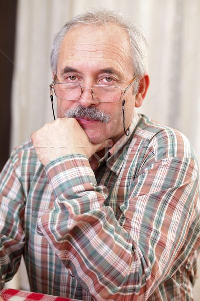Knorrig senior man portret bril gezicht Stockfoto © Lighthunter