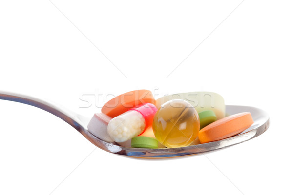 Various drugs vitamins and nutrition supplements on spoon. Stock photo © Lighthunter