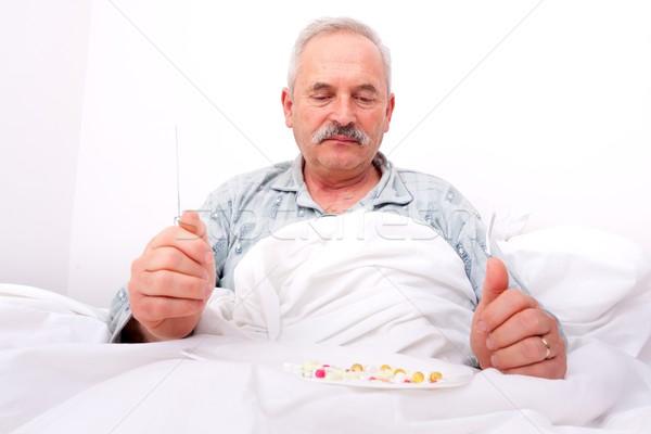 Elderly man eating meds Stock photo © Lighthunter