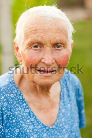 Laughing elderly woman outdoors Stock photo © Lighthunter