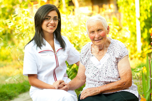 Caring doctor with happy elderly lady Stock photo © Lighthunter