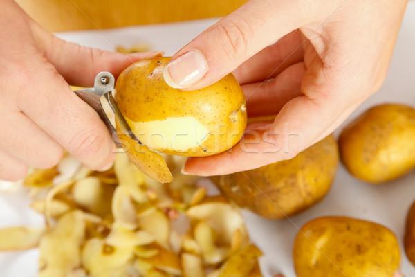 Peeling potato Stock photo © Lighthunter