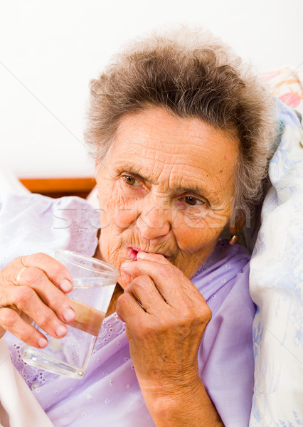 Elderly Taking Pills Stock photo © Lighthunter