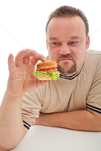 Man not happy about the size of his hamburger - closeup Stock photo © lightkeeper
