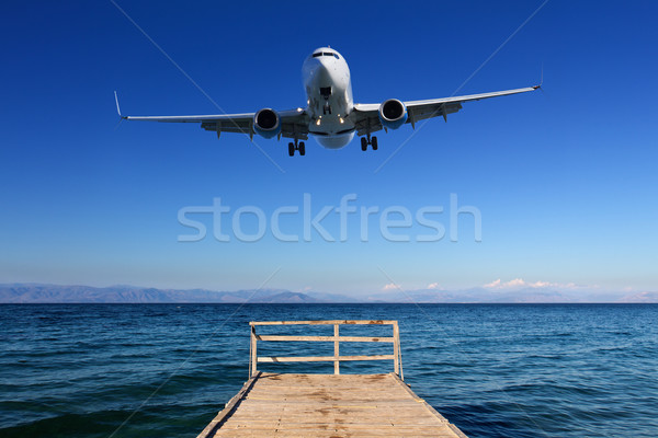 Landing in paradise - airplane approaching ground Stock photo © lightkeeper