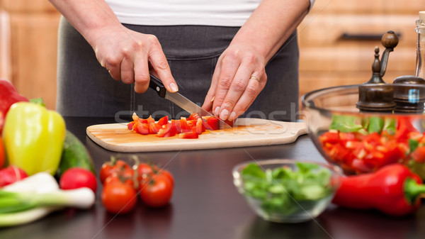 Woman chopping vegetables for a salad - closeup on hands Stock photo © lightkeeper