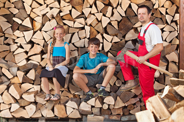 Father and kids prepared to chop firewood and stack it into a wo Stock photo © lightkeeper