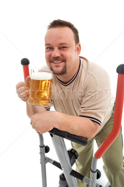 Man exercising with a beer Stock photo © lightkeeper