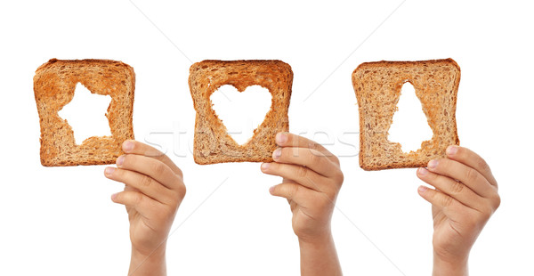 Bread slices with christmas symbols cutouts Stock photo © lightkeeper