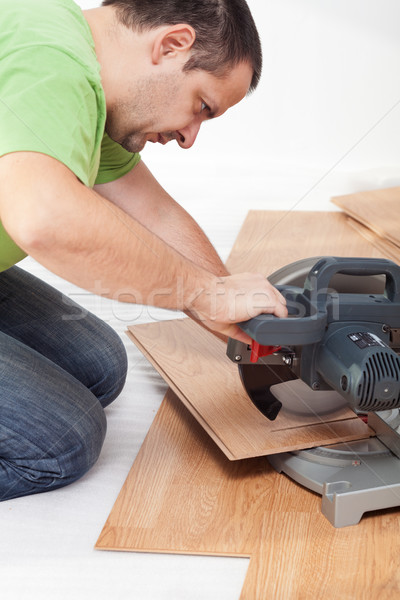 Cutting and laying laminate flooring planks Stock photo © lightkeeper