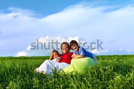 Spring panorama with family sitting outdoors Stock photo © lightkeeper